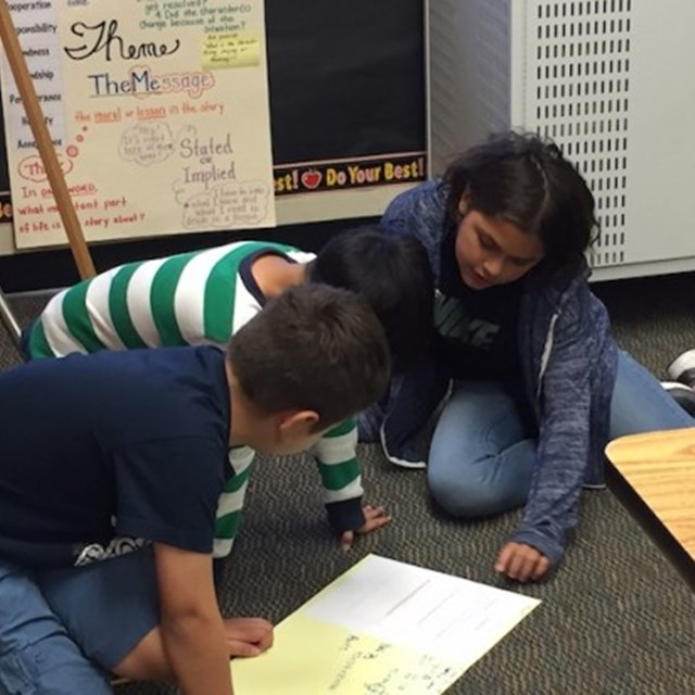 Students collaborate on math problems and come up with ways to present their thinking process!