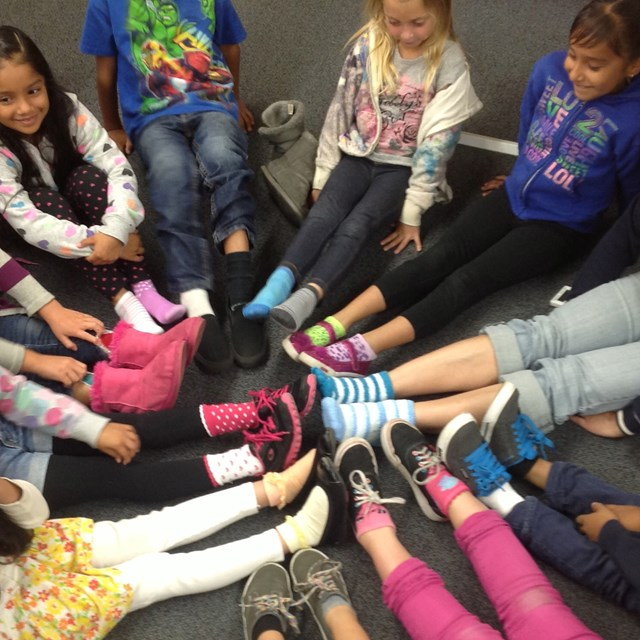 Students form the colors of the rainbow with their tacky socks.